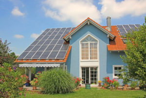 Modern New Built House And Garden Rooftop With Solar